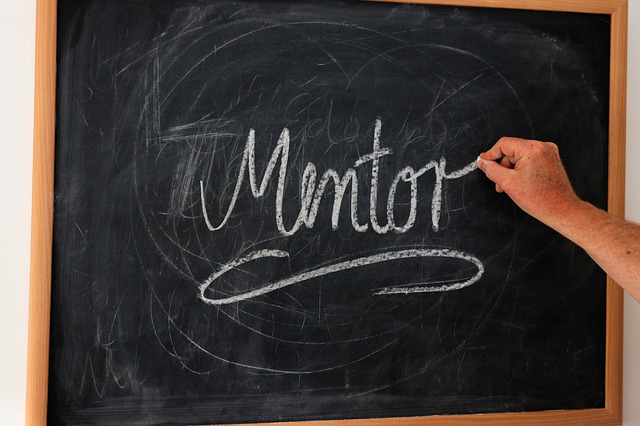A chalkboard with the word mentor written on it in chalk. The article is about how to get a mentor. Finding Mentors