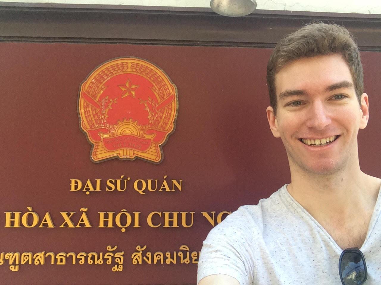 Elliott Killian ElliottKillian in front of the Vietnamese Embassy in Bangkok Thailand. The sign is in Vietnamese and in Thai.