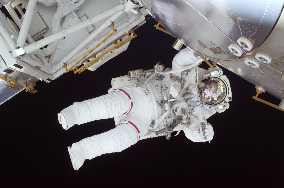 An Astronaut floating in space next to a space craft. The Astronaut is in a space suit and is almost horizontal. Dream Job, Career advice