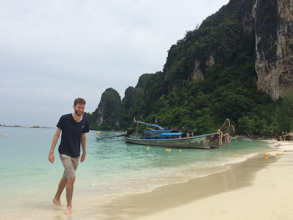Elliott Killian in Koh Phi Phi island Thailand. He is walking on the beach