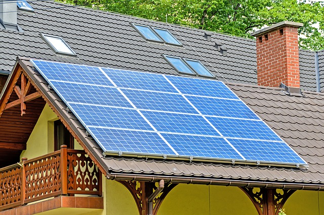 A house with solar panels on it. The article is about SolarCity and Tesla. The future of the grid will probably be solar panels using batteries and electric vehicles.